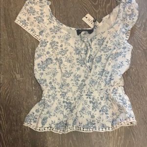 White and blue floral shirt